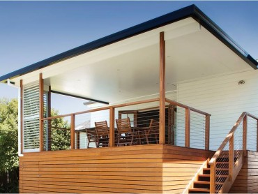A flat skillion insulated roof built on a timber deck with adjustable louvres.